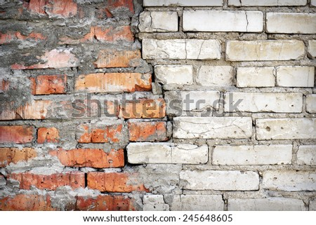 Old damaged brick wall texture - stock photo