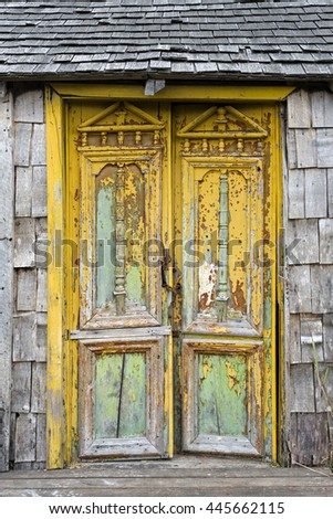Old damaged door in Castro, Chiloe Island, Chile