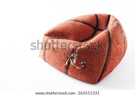 Old damaged rubber basket ball on background - stock photo
