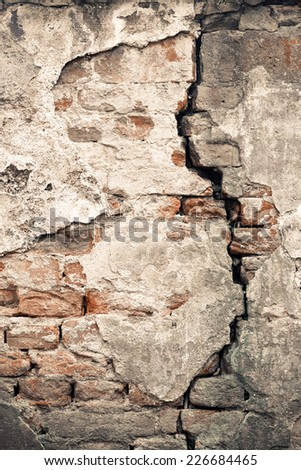 Old damaged wall with a big crack texture - stock photo