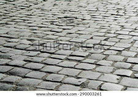 Old damp gray cobble-stone texture, abstract background - stock photo