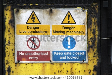 Old danger signs on heavy industrial site.
