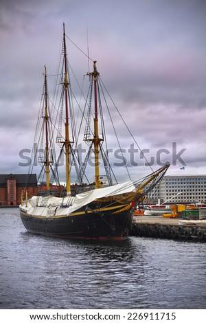 Old Danish wooden ship at the harbor in Copenhagen, Denmark - stock photo