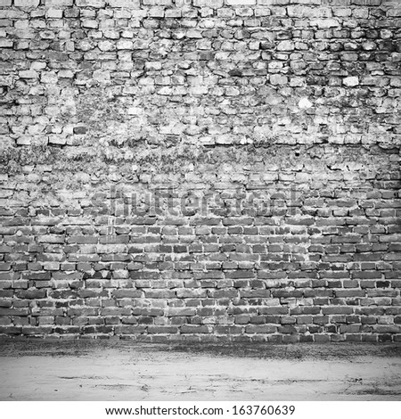 Old dark brick wall floor interior on street - stock photo