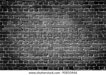 Old dark brick wall, texture background - stock photo
