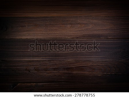 Old dark brown wooden boards with vignette - stock photo