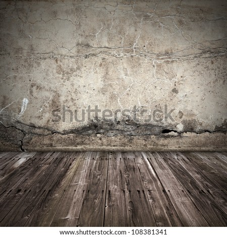 Old dark grunge interior background with concrete wall and weathered wooden lining boards floor - stock photo