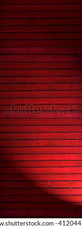 Old  dark red painted wooden wall  with spotlight- texture or background - stock photo