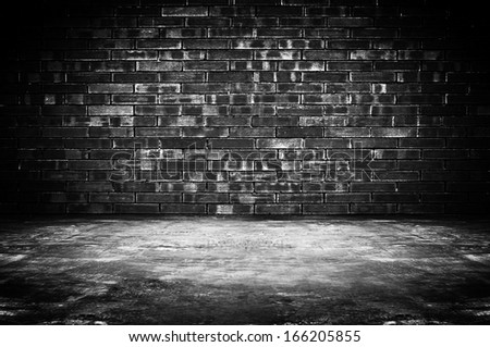 Old dark room with brick wall and concrete floor - as background - stock photo