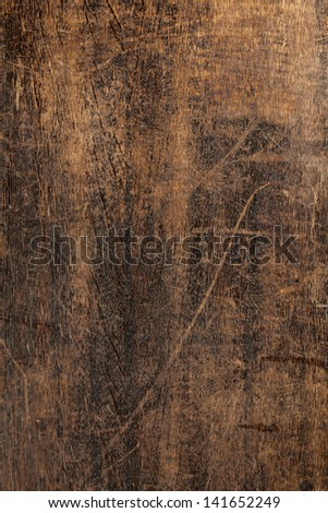 old dark wood texture - old table with scratches - stock photo