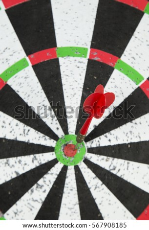 old dart target with arrows