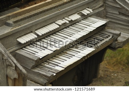 old decaying organ left to rot in field - stock photo