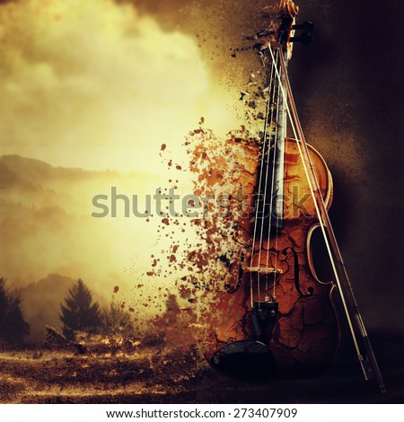 Old decaying violin. - stock photo