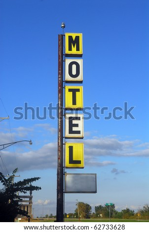 Old decayingmotel sign along the famous Route 66 - stock photo