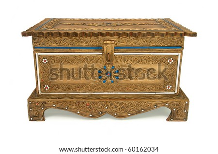 Old decorated treasure chest isolated on white background. - stock photo