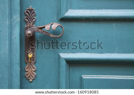Old decorative door handles - stock photo