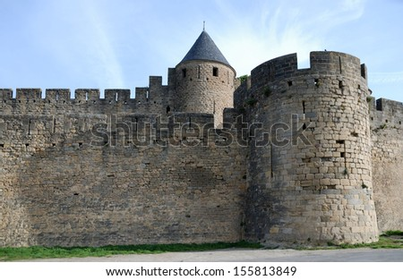 Old defense stone walls with towers of Carcasson castle, France