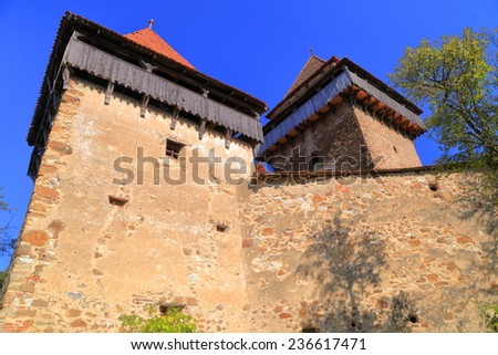 Old defensive towers of a church on UNESCO world heritage list, Viscri village, Transylvania, Romania - stock photo