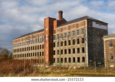 old derelict mill laying abandoned in countryside