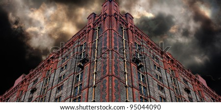 Old derelict victorian warehouse - stock photo
