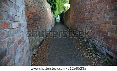 Old Deserted Alleyway Background - stock photo