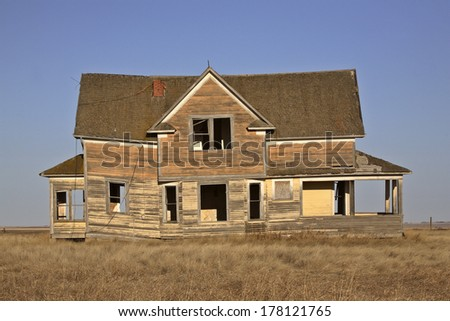 Old deserted farm house - stock photo
