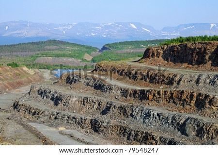 Old deserted opencast. Summer landscape. Northwest of Russia - stock photo