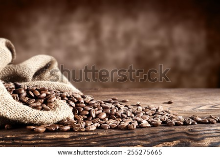 old desk of coffee beans and sack  - stock photo