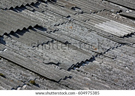 Old destroyed asbestos roof. Asbestos roofing design.