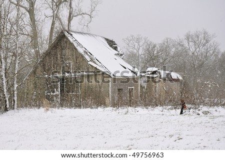 Old destroyed house in snow