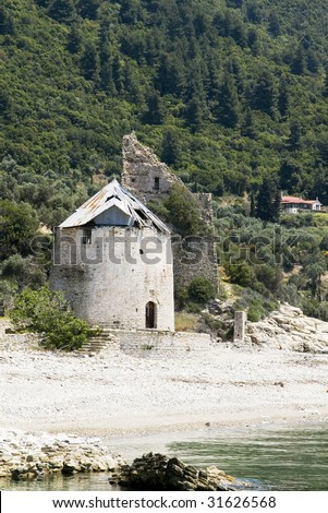 Old destroyed mill and Venetian sentry serf tower on coast, Sografu, Athos, Greece