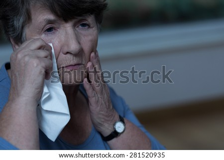 Old devastated women in mourning is crying - stock photo