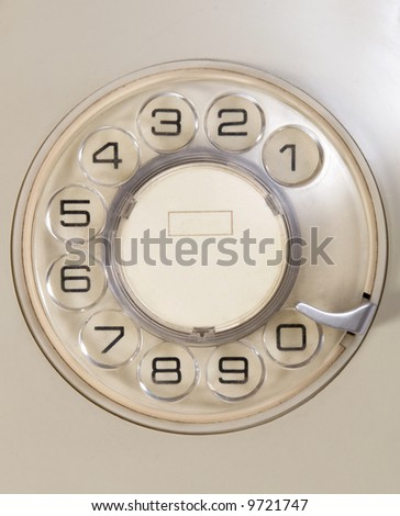 Old dial telephone in beige color.