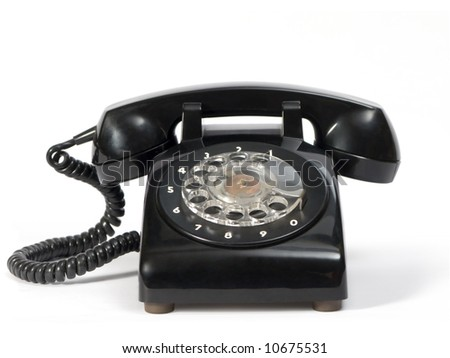 Old dial telephone in black color. - stock photo