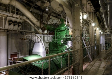 Old diesel generator installed on cargo ship - stock photo
