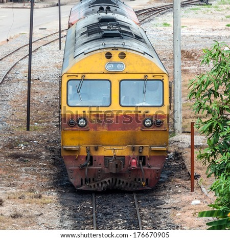Old diesel locomotive in the maintenance area of railway station. - stock photo