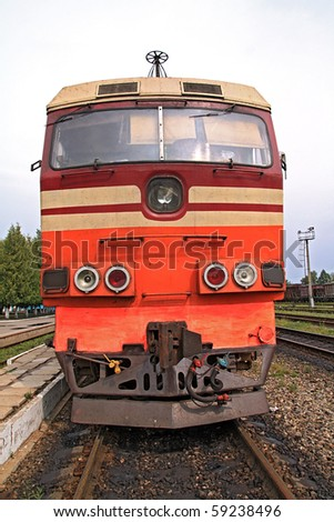 old diesel locomotive on railway station - stock photo