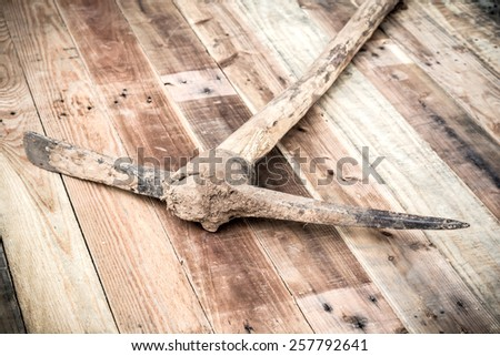 old diggers tools on wooden table - stock photo