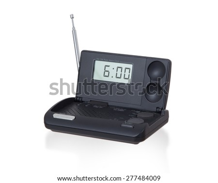 Old digital radio alarm clock isolated on white - Time is 6:00 - stock photo