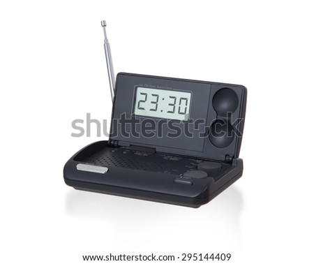 Old digital radio alarm clock isolated on white - Time is 23:30 - stock photo
