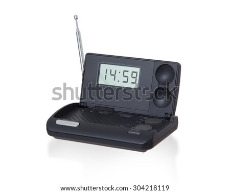 Old digital radio alarm clock isolated on white - Time is 14:59 - stock photo