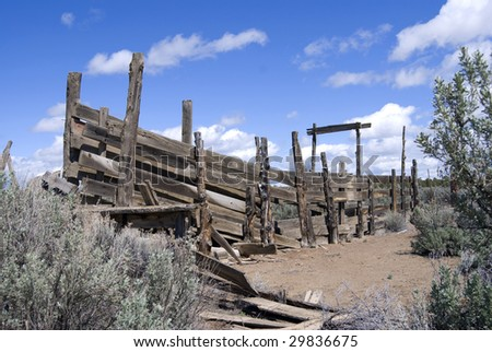 Old dilapidated cattle loading chute among the sage and rabbit brush in the Central Oregon desert. - stock photo