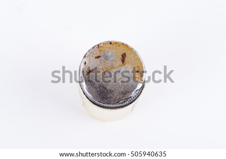 Old dirty aluminium lid or jar cap isolated on white background (top view). Template for work and education.