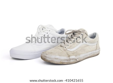 Old dirty and new white sneakers isolated - stock photo