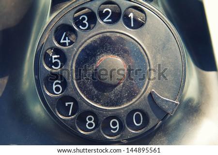 old dirty black retro telephone disk dealer - stock photo
