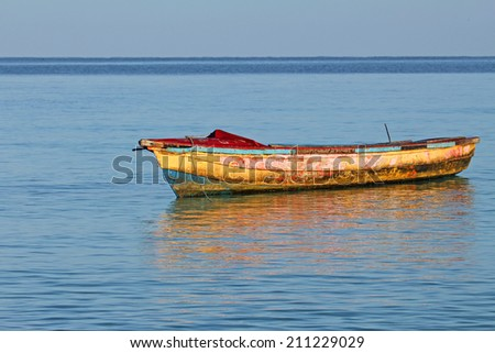 Old dirty boat, Jamaica - stock photo