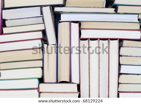 Old dirty books on book shelf background - stock photo