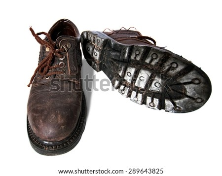 Old dirty boots on a white background  - stock photo