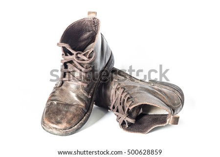 Old dirty boots on a white background