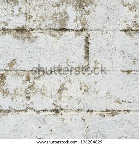 Old dirty brick wall fragment as a background texture - stock photo